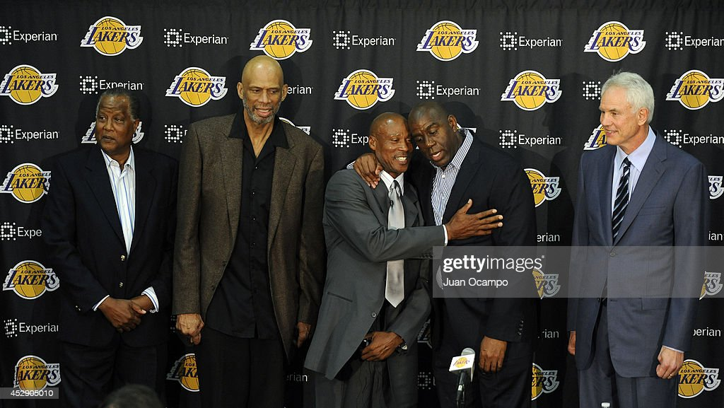 Jamaal Wilkes, Kareem Abdul-Jabbar, Byron Scott, Earvin 'Magic' Johnson and Mitch Kupchak pose for a picture during a press conference to introduce Byron Scott as the new head coach of the Los Angeles Lakers on July 29, 2014 at Toyota Sports Center in El Segundo, California.