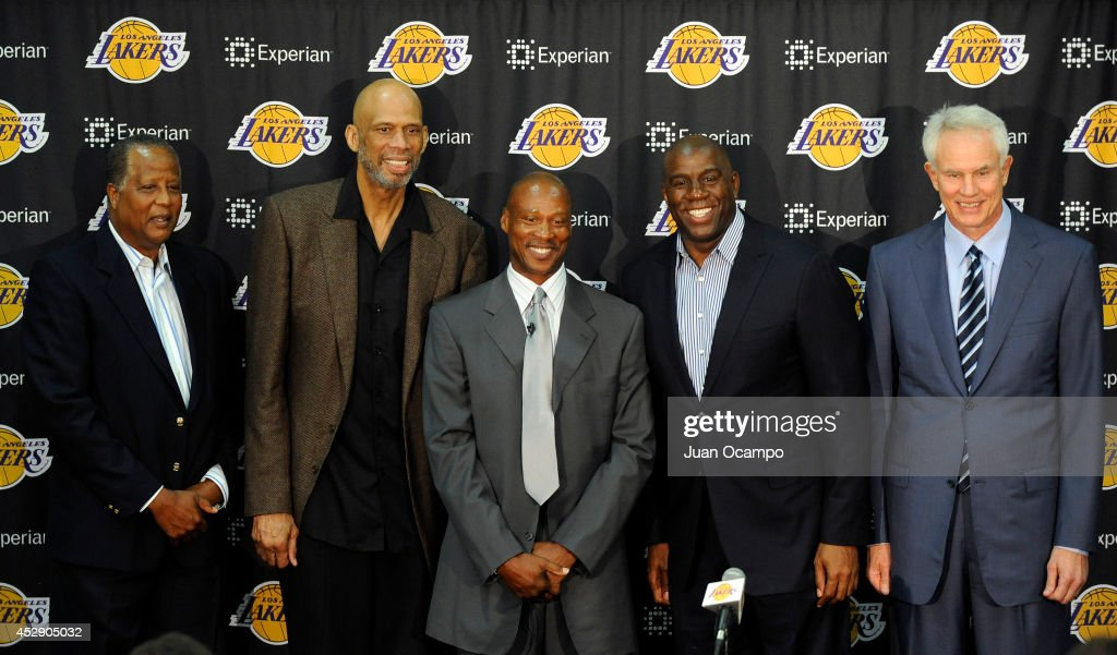 <a gi-track='captionPersonalityLinkClicked' href=/galleries/search?phrase=Jamaal+Wilkes&family=editorial&specificpeople=796432 ng-click='$event.stopPropagation()'>Jamaal Wilkes</a>, <a gi-track='captionPersonalityLinkClicked' href=/galleries/search?phrase=Kareem+Abdul-Jabbar&family=editorial&specificpeople=206219 ng-click='$event.stopPropagation()'>Kareem Abdul-Jabbar</a>, <a gi-track='captionPersonalityLinkClicked' href=/galleries/search?phrase=Byron+Scott+-+Basketball+Coach&family=editorial&specificpeople=209087 ng-click='$event.stopPropagation()'>Byron Scott</a>, Earvin 'Magic' Johnson and <a gi-track='captionPersonalityLinkClicked' href=/galleries/search?phrase=Mitch+Kupchak&family=editorial&specificpeople=753399 ng-click='$event.stopPropagation()'>Mitch Kupchak</a> pose for a picture during a press conference to introduce <a gi-track='captionPersonalityLinkClicked' href=/galleries/search?phrase=Byron+Scott+-+Basketball+Coach&family=editorial&specificpeople=209087 ng-click='$event.stopPropagation()'>Byron Scott</a> as the new head coach of the Los Angeles Lakers on July 29, 2014 at Toyota Sports Center in El Segundo, California.