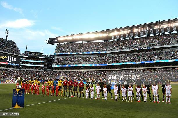 Jamaica and Mexico stand on the field before the CONCACAF Gold Cup Final at Lincoln Financial Field on July 26 2015 in Philadelphia Pennsylvania...