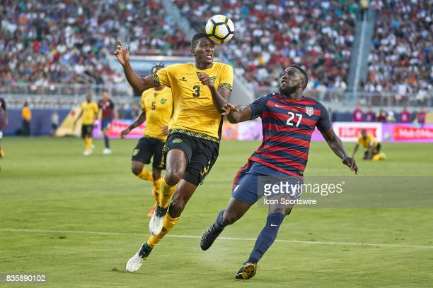 Jamaica defender Damion Lowe battles with United States forward Jozy Altidor for the ball during the CONCACAF Gold Cup Final match between the United...