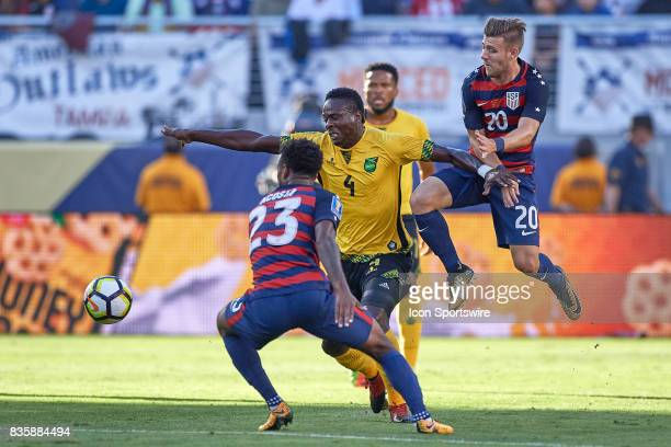Jamaica defender Ladale Richie battles with United States midfielder Paul Arriola and United States midfielder Kellyn Acosta during the CONCACAF Gold...