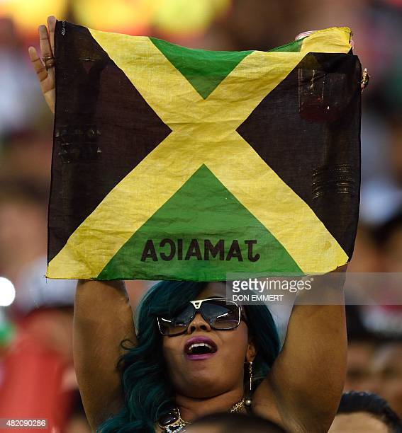 Jamaica football fan cheers before the 2015 CONCACAF Gold Cup final between Jamaica and Mexico in Philadelphia on July 26 2015 AFP PHOTO/DON EMMERT