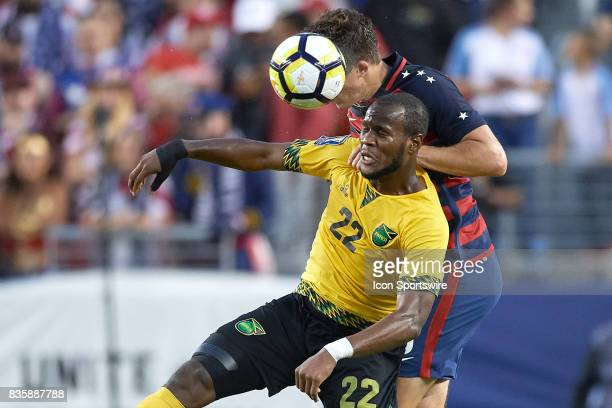 Jamaica forward Romario Williams battles with United States defender Matt Besler for a header during the CONCACAF Gold Cup Final match between the...