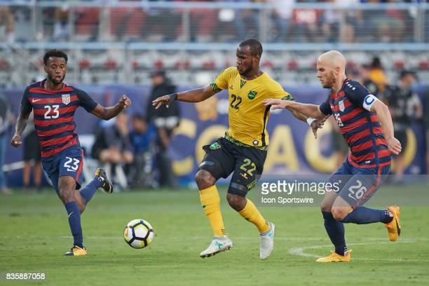 Jamaica forward Romario Williams battles with United States midfielder Kellyn Acosta and United States midfielder Michael Bradley during the CONCACAF...