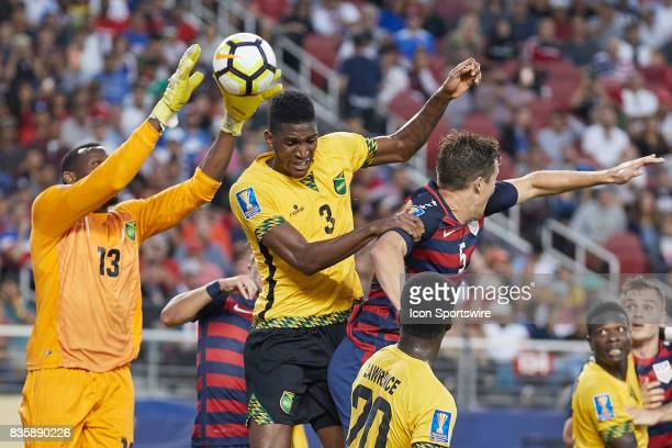 Jamaica goalkeeper Duwayne Miller battles with Jamaica defender Damion Lowe and United States defender Matt Besler to make a save during the CONCACAF...