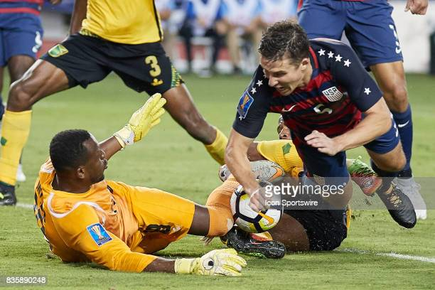 Jamaica goalkeeper Duwayne Miller collide with United States defender Matt Besler during the CONCACAF Gold Cup Final match between the United States...