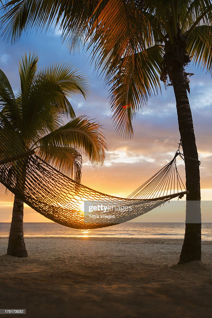 Jamaica, Hammock on beach at sunset
