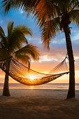 Jamaica, Hammock on beach at sunset