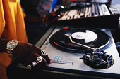 Jamaica, Kingston city, male DJ playing music, close-up of hand