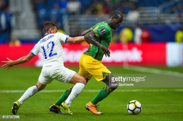 Jamaica midfielder JeVaughn Watson tries to keep the ball from El Salvador midfielder Narciso Orellana during the CONCACAF Gold Cup soccer match...