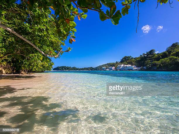 Jamaica, Port Antonio, blue lagoon with luxury villas in background