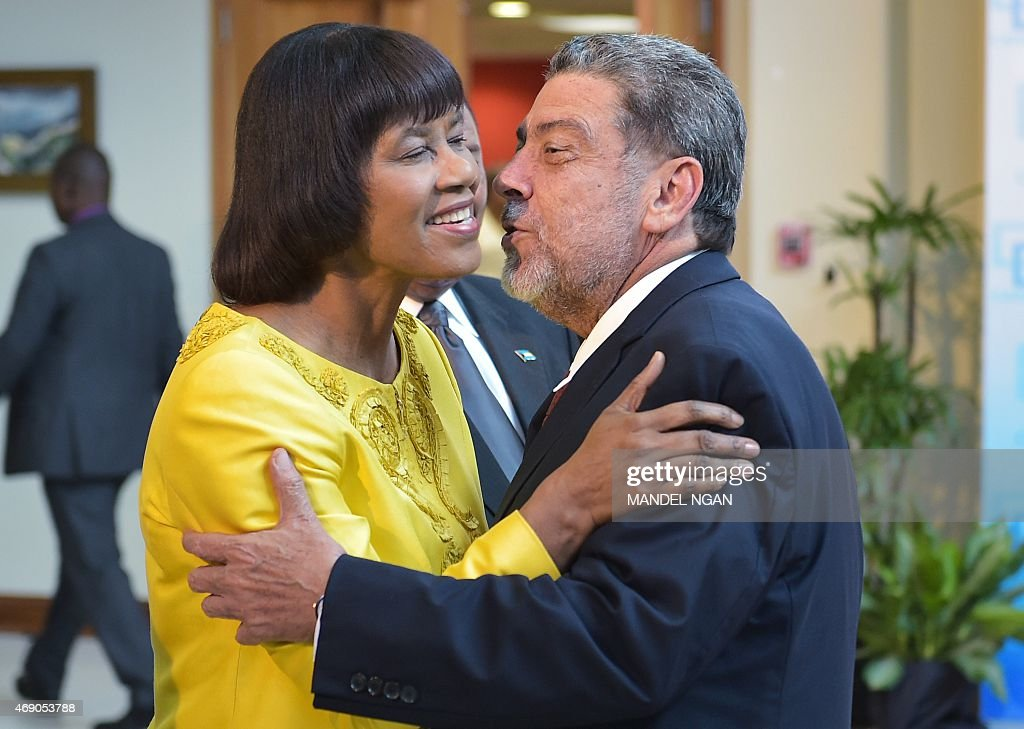 Jamaica Prime Minister <a gi-track='captionPersonalityLinkClicked' href=/galleries/search?phrase=Portia+Simpson+Miller&family=editorial&specificpeople=4183773 ng-click='$event.stopPropagation()'>Portia Simpson Miller</a> (L) greets Saint Vincent and the Grenadines Prime Minister Ralph Gonsalves (R) as he arrives for a Caribbean Community (CARICOM) leaders meeting at the University of the West Indies on April 9, 2015 in Kingston.