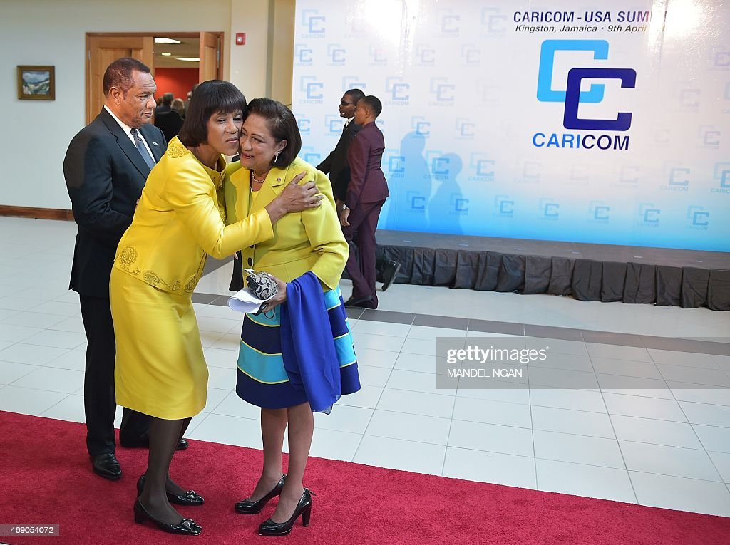 Jamaica Prime Minister <a gi-track='captionPersonalityLinkClicked' href=/galleries/search?phrase=Portia+Simpson+Miller&family=editorial&specificpeople=4183773 ng-click='$event.stopPropagation()'>Portia Simpson Miller</a> (L) greets Trinidad and Tobago Prime Minister Kamla Persad-Bissessar as she arrives for a Caribbean Community (CARICOM) leaders meeting at the University of the West Indies on April 9, 2015 in Kingston.