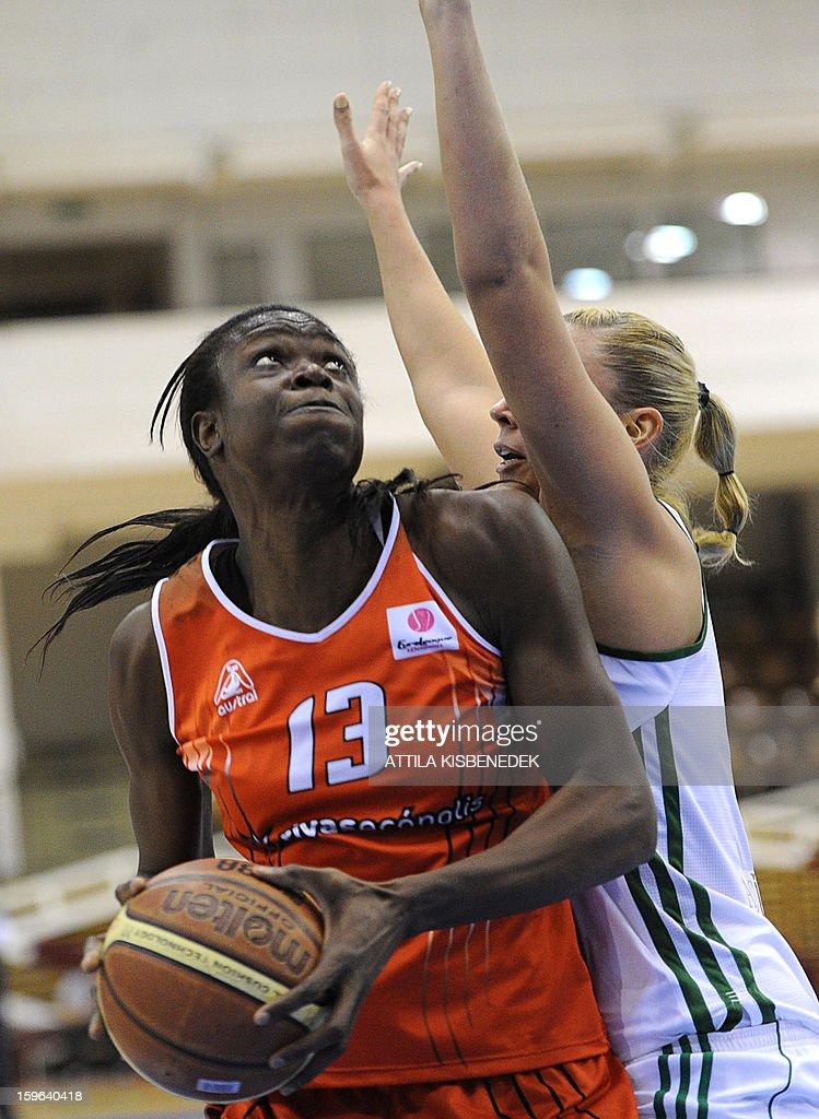 Jamaican Aneika Henry (L) of Spanish Rivas Ecopolis vies for the ball with Györgyi Öri (R) of Hungarian Hat-Agro UNI Gyor during the Women Euroleague basketball match on January 17, 2013.