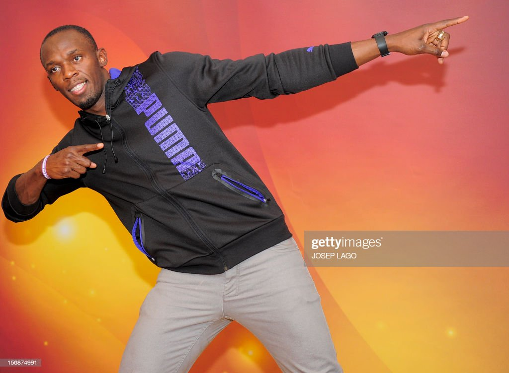 Jamaican athlete Usain Bolt poses for photographers on November 23, 2012 in Barcelona on the eve of the IAAF (International Association of Athletics Federations) Athlete of the Year Award marking the centenay of IAAF. AFP PHOTO/ JOSEP LAGO