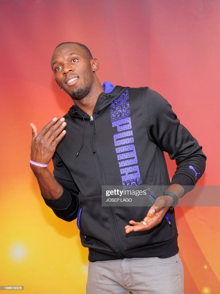 Jamaican athlete Usain Bolt poses for photographers on November 23, 2012 in Barcelona on the eve of the IAAF (International Association of Athletics Federations) Athlete of the Year Award marking the centenay of IAAF.