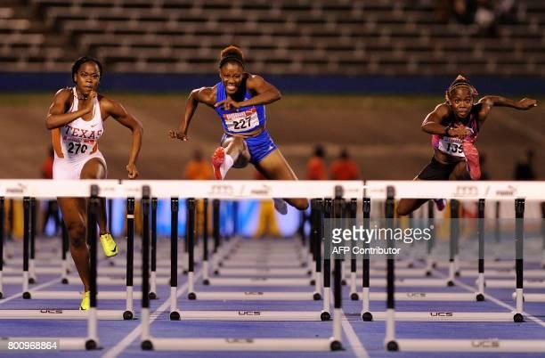 TOPSHOT Jamaican athletes Rushelle Burton Danielle Williams and Megan Simmonds compete in the womens 100m hurdles finalheld at the National Stadium...