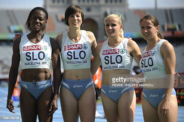 Jamaican born Slovenian veteran sprinter Merlene Ottey poses with teammates after competing in the first round of the women's 4x100m heat 1 relay at...