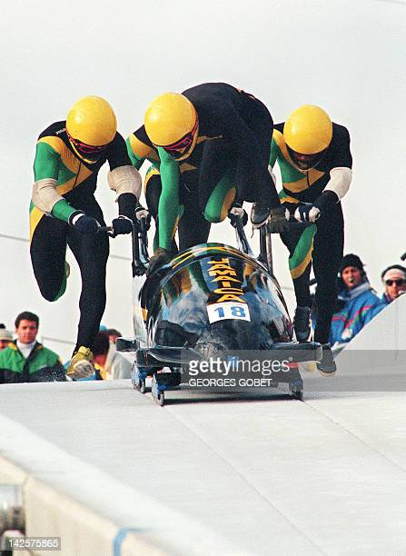 Jamaican fourman bobsleigh pilot Dudley Stokes jumps in as his three teammates push off at the start of the second run of the Olympic fourman...