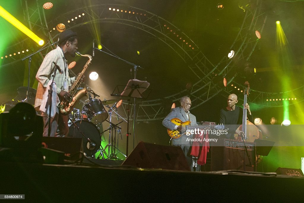 Jamaican musician and composer Ernest Ranglin (C) performs during the 15th International Mawazine Music festival at Bouregreg concert hall, in Rabat, Morocco on May 27, 2016.