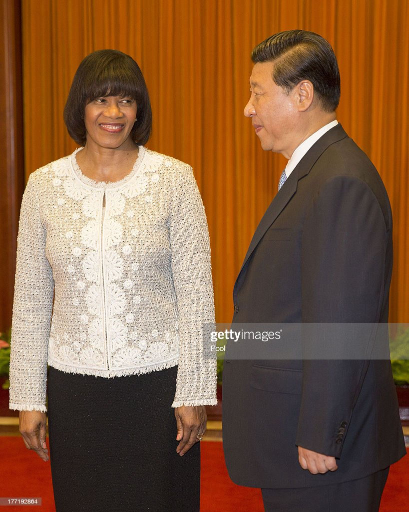 Jamaican Prime Minister <a gi-track='captionPersonalityLinkClicked' href=/galleries/search?phrase=Portia+Simpson+Miller&family=editorial&specificpeople=4183773 ng-click='$event.stopPropagation()'>Portia Simpson Miller</a> and Chinese President <a gi-track='captionPersonalityLinkClicked' href=/galleries/search?phrase=Xi+Jinping&family=editorial&specificpeople=2598986 ng-click='$event.stopPropagation()'>Xi Jinping</a> attend talks at the Great Hall of the People, on August 22, 2013 in Beijing, China. Simpson Miller is on a five day visit to China to bolster economic and diplomatic ties.