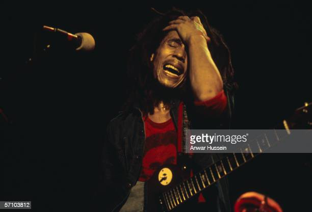 Jamaican reggae singer Bob Marley performing on stage circa 1975