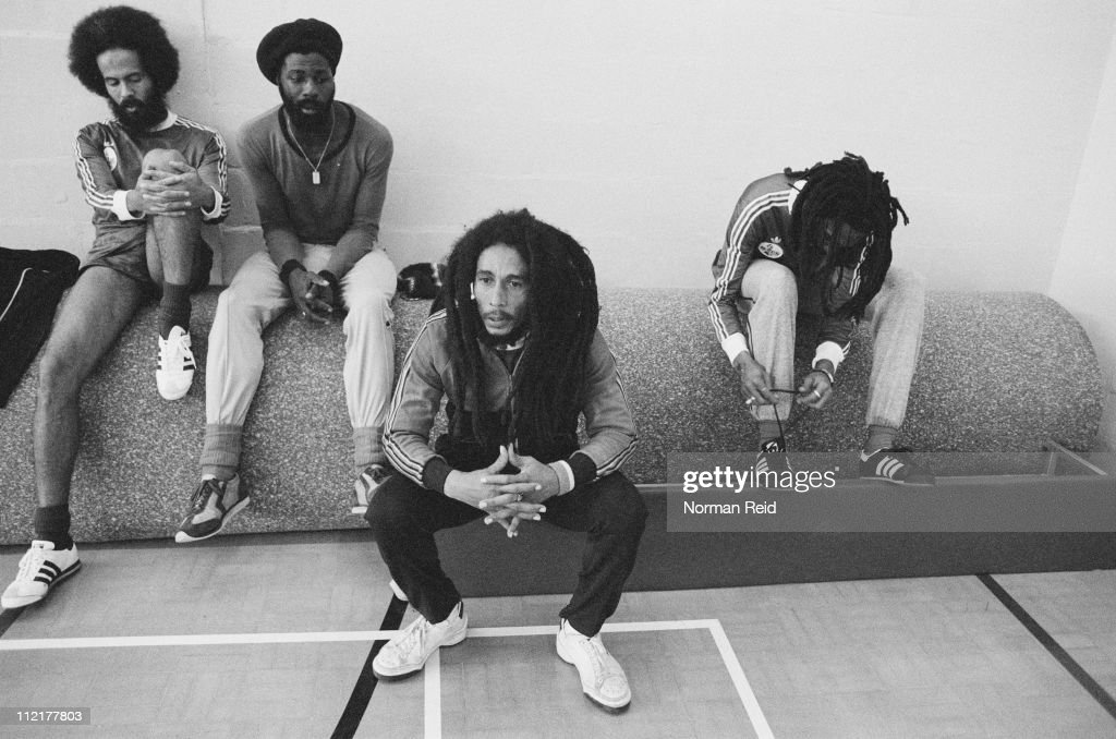 Jamaican singer-songwriter <a gi-track='captionPersonalityLinkClicked' href=/galleries/search?phrase=Bob+Marley+-+Musician&family=editorial&specificpeople=240470 ng-click='$event.stopPropagation()'>Bob Marley</a> (1945 - 1981, centre) takes a break during a football match against a team led by fellow reggae artist Eddy Grant, Hammersmith Leisure Centre, London, 16th July 1980, L-R Jamaican National team player Alan 'Skill' Cole, Derek Donaldson, <a gi-track='captionPersonalityLinkClicked' href=/galleries/search?phrase=Bob+Marley+-+Musician&family=editorial&specificpeople=240470 ng-click='$event.stopPropagation()'>Bob Marley</a>, Neville Garrick.