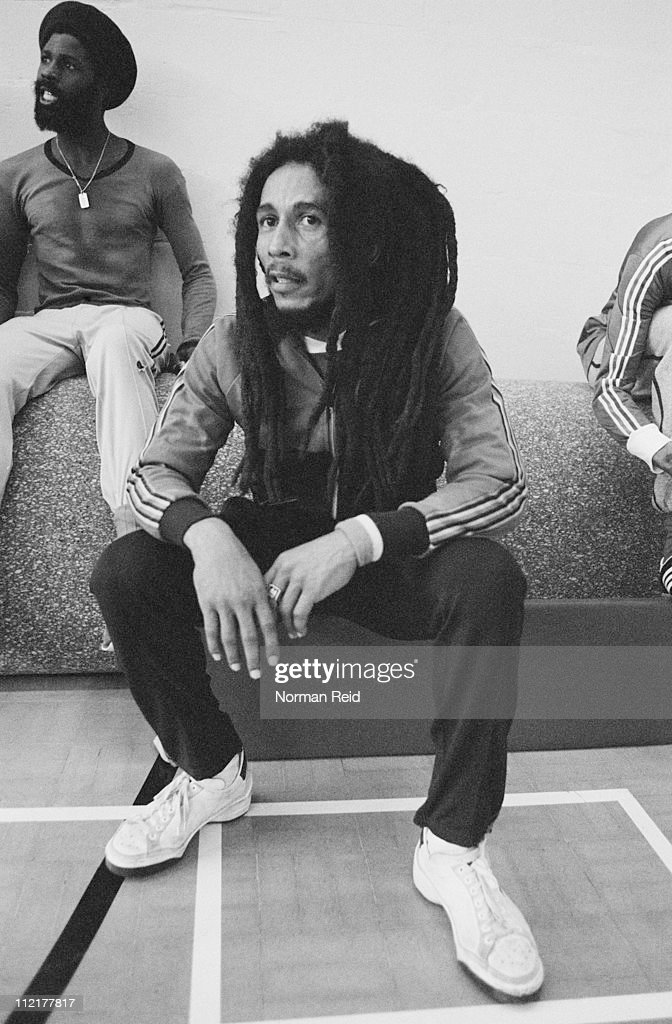 Jamaican singer-songwriter <a gi-track='captionPersonalityLinkClicked' href=/galleries/search?phrase=Bob+Marley+-+Musician&family=editorial&specificpeople=240470 ng-click='$event.stopPropagation()'>Bob Marley</a> (1945 - 1981) takes a break during a football match against a team led by fellow reggae artist Eddy Grant, Marley's freind Derek Donaldson sits behind, Hammersmith Leisure Centre, London, 16th July 1980.