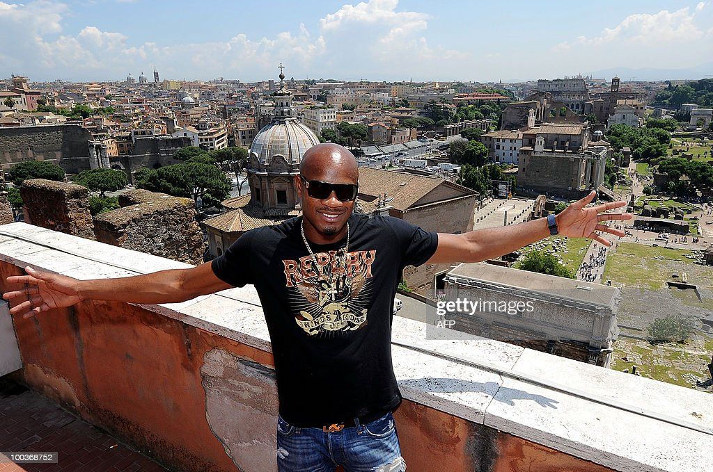 Jamaican sprinter Asafa Powell, who specialises in the 100 metres, poses in front of Rome's Fori Imperiali, on May 24, 2010, at the end of a news conference held to illustrate the next Golden Gala athletic event that will be staged on June 10, 2010 at the Olympic Stadium in Rome.
