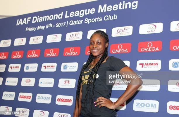 Jamaican sprinter Elaine Thompson poses for a picture following a press conference in the Qatari capital Doha on May 4 a day before the start of the...