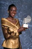 Jamaican sprinter Merlene Ottey with an award trophy at the International Athletic Foundation World Athletics Gala in Monte Carlo Monaco December 1994