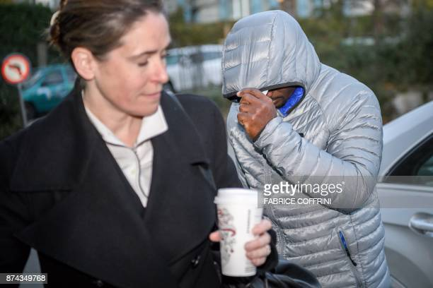 Jamaican sprinter Nesta Carter hides his face from reporters upon his arrival to his appeal hearing before the Court of Arbitration for Sport over...