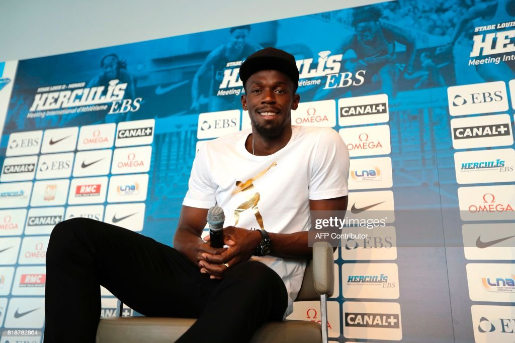 Jamaican sprinter Usain Bolt poses during a press conference on June 19, 2017 in Monaco, two days ahead of his race at the IAAF Diamond League meeting in London. / AFP PHOTO / Valery HACHE