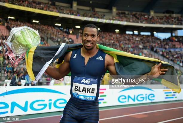 Jamaican sprinter Yohan Blake celebrates after competing in the Men's 100 metres event at the AG Insurance Memorial Van Damme athletics event the...