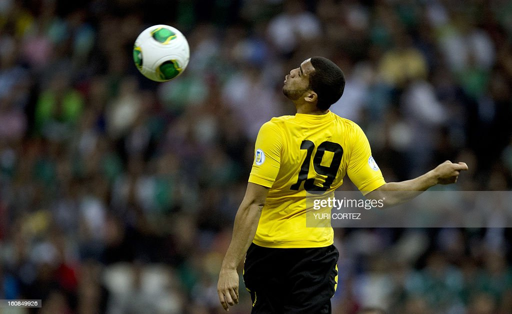 Jamaica's Adrian Mariappa heads the ball during their their Brazil-2014 FIFA World Cup CONCACAF football qualifier match against Mexico at the Azteca stadium in Mexico City, on February 6, 2013.