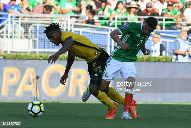 Jamaica's Alvas Powell battles with Mexico's Orbelin Pineda during their CONCACAF Gold Cup semifinal match in Pasadena California on July 23 2017 /...
