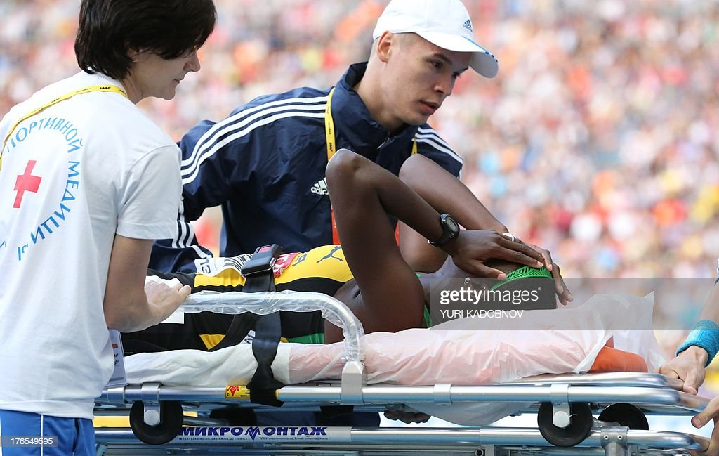 Jamaica's Anneisha McLaughlin is taken away on a stretcher after the women's 200 metres semi-final the 2013 IAAF World Championships at the Luzhniki stadium in Moscow on August 15, 2013.