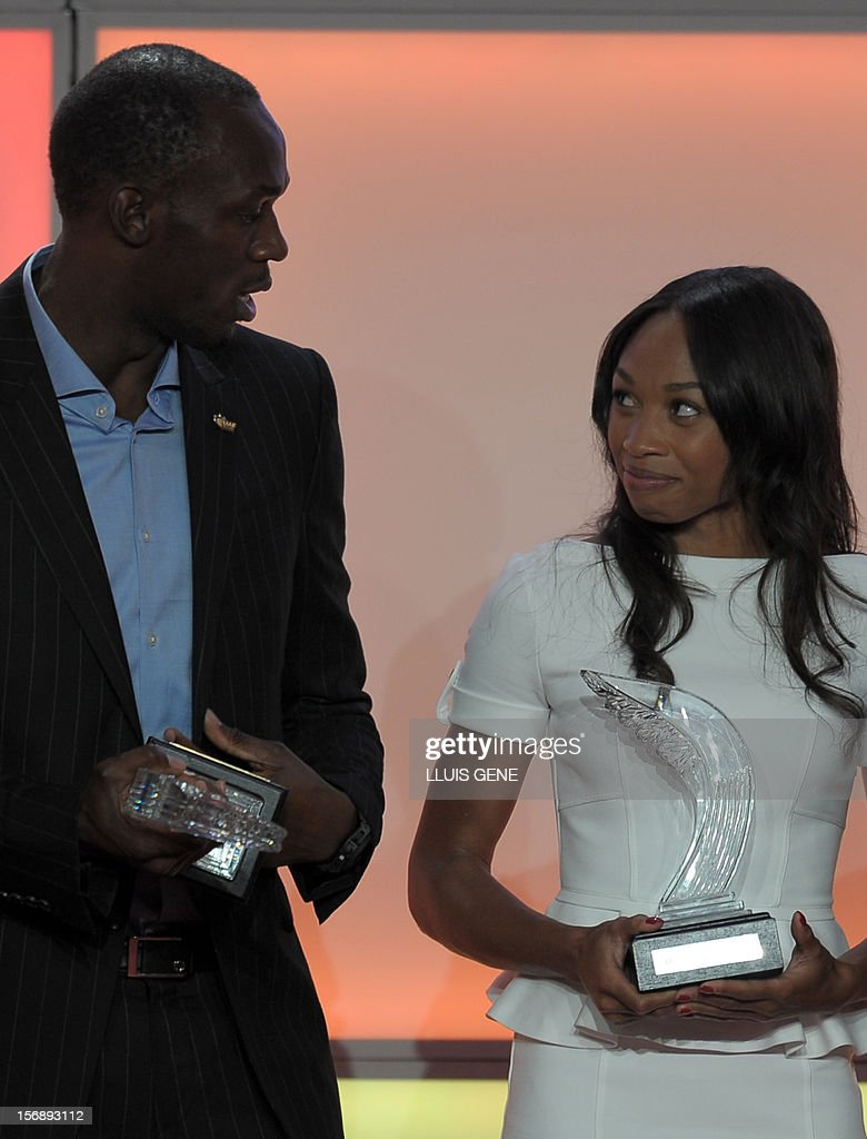 Jamaica's athlete Usain Bolt (L) and US sprinter Allyson Felix react as they pose with their IAAF's Athlete of the Year trophies during the IAAF (International Association of Athletics Federations)'s Athlete of the Year Award marking its centenary on November 24, 2012 in Barcelona. AFP PHOTO/ LLUIS GENE