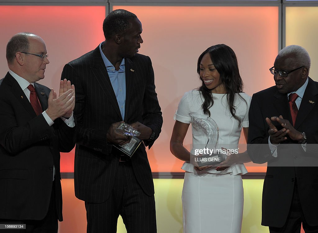 Jamaica's athlete Usain Bolt (2ndL) and US sprinter Allyson Felix (2ndR) react with their IAAF's Athlete of the Year trophies as Prince Albert of Monaco (L) and IAAF (International Association of Athletics Federations) President Lamine Diack applaud during the IAAF (International Association of Athletics Federations)'s Athlete of the Year Award marking its centenary on November 24, 2012 in Barcelona.