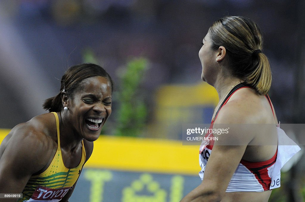 Jamaica's Brigitte Foster-Hylton (L) and Canada's Priscilla Lopes-Schliep celebrate after the women's 100m hurdles final race of the 2009 IAAF Athletics World Championships on August 19, 2009 in Berlin.