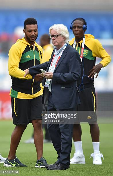 Jamaica's coach Winfried Schäfer speaks to players moments before the start of the 2015 Copa America football championship match against Uruguay in...