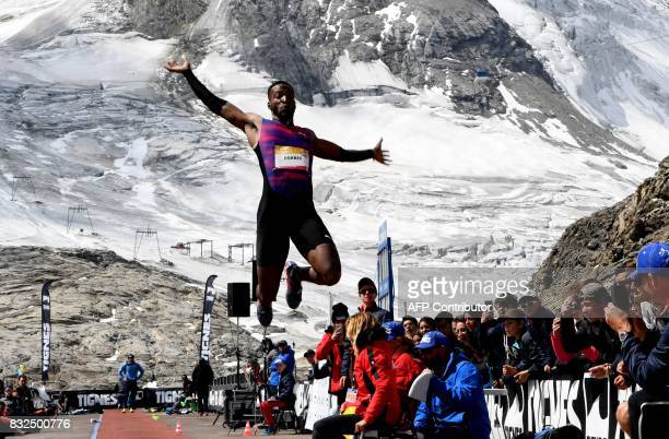 Jamaica's Damar Forbes competes in the men's long jump during 'The Jump of the Giants' Tignes Athletics Open at the foot of the Tignes glacier 3032m...
