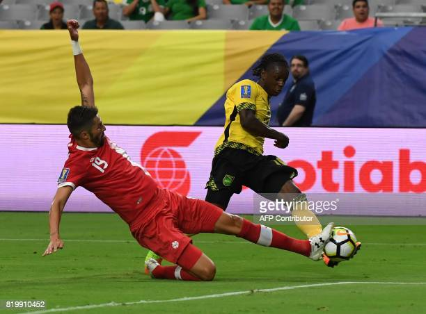 Jamaica's Darren Mattocks is blocked by Canada's Steven Vitoria as he takes a shot on goal during their quarterfinal of the 2017 CONCACAF Gold Cup at...