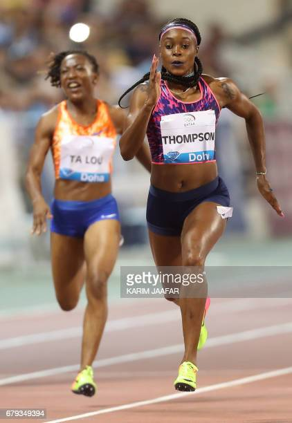 Jamaica's Elaine Thompson and Ivory Coast's MarieJosee Ta Lou compete in the women's 200 metres during the Diamond League athletics competition at...