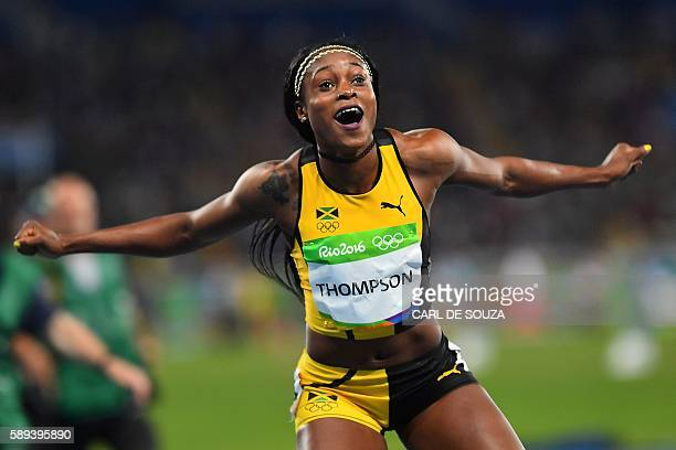 TOPSHOT Jamaica's Elaine Thompson celebrates after she won the Women's 100m Final during the athletics event at the Rio 2016 Olympic Games at the...