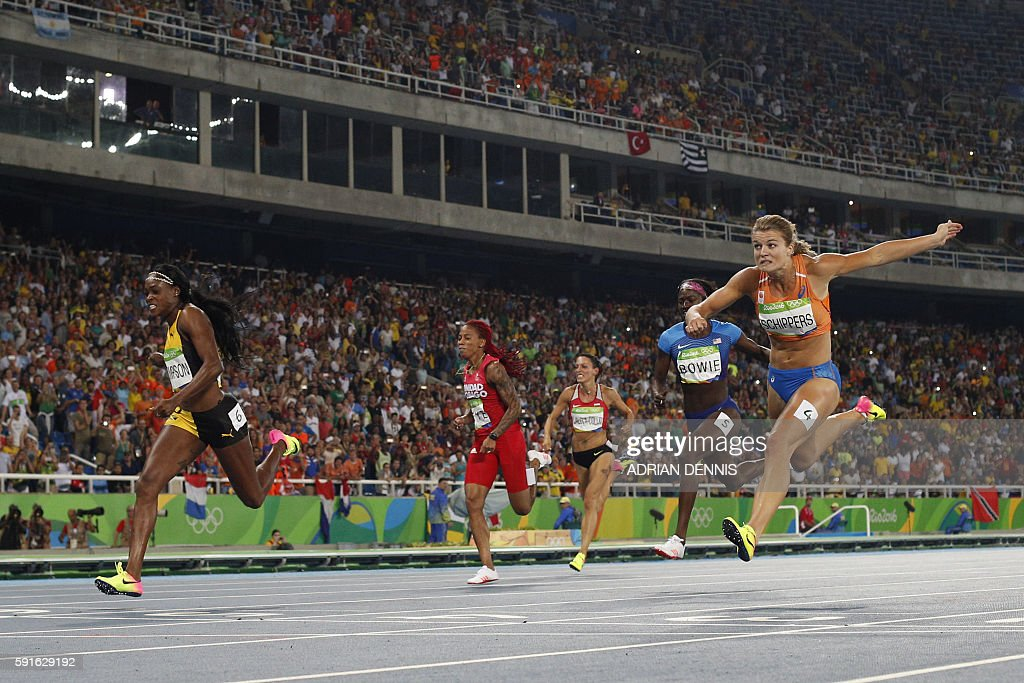Jamaica's Elaine Thompson crosses the finish line ahead of silver medallist Netherlands' Dafne Schippers bronze medallist USA's Tori Bowie Bulgaria's...