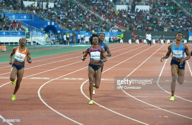 Jamaica's Elaine Thompson crosses the finish line to win the 100m race as Ivory Coast's MarieJosee Ta Lou takes second place and Blessing...