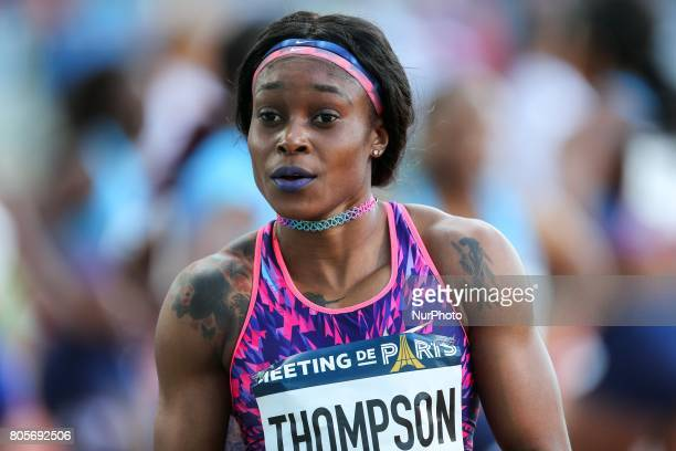 Jamaica's Elaine Thompson gestures after winning the women's 100 meters within the International Association of Athletics Federations Diamond League...