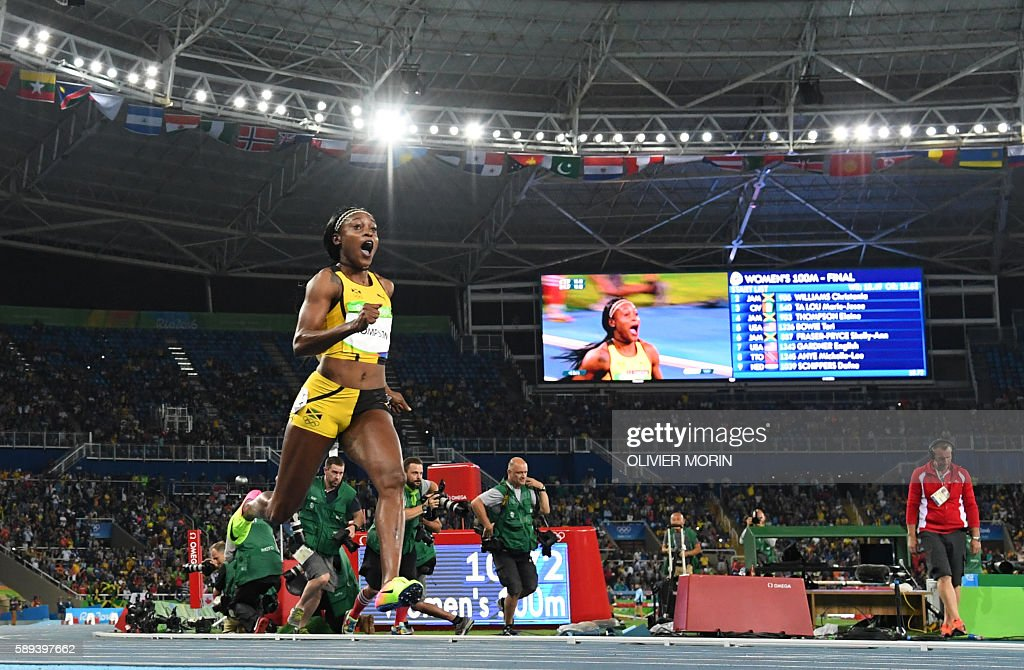 TOPSHOT - Jamaica's Elaine Thompson reacts after she crossed the finish line to win in the Women's 100m Final during the athletics event at the Rio 2016 Olympic Games at the Olympic Stadium in Rio de Janeiro on August 13, 2016. / AFP / OLIVIER