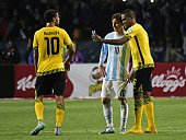 Jamaica's forward DeShorn Brown poses for a selfie with Argentina's forward Lionel Messi as Jamaica's midfielder Joel McAnuff reacts during their...